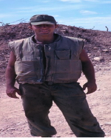 Tom wearing a Marine flak jacket in South Vietnam.
