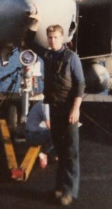 Jim McCune standing by an F-14 on USS KITTY HAWK.