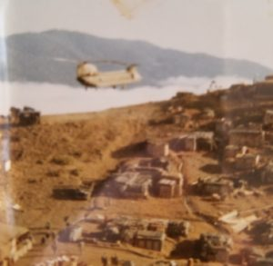 Photo of a helicopter resupplying San Juan Hill in Vietnam.