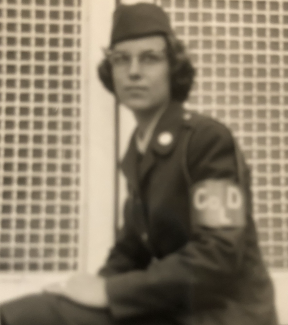 Image of Sue Hodge in uniform sitting on a bench.